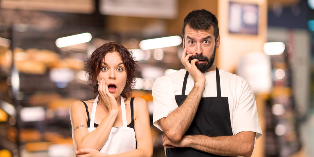 Couple,of,cooks,surprised,and,shocked,while,looking,right