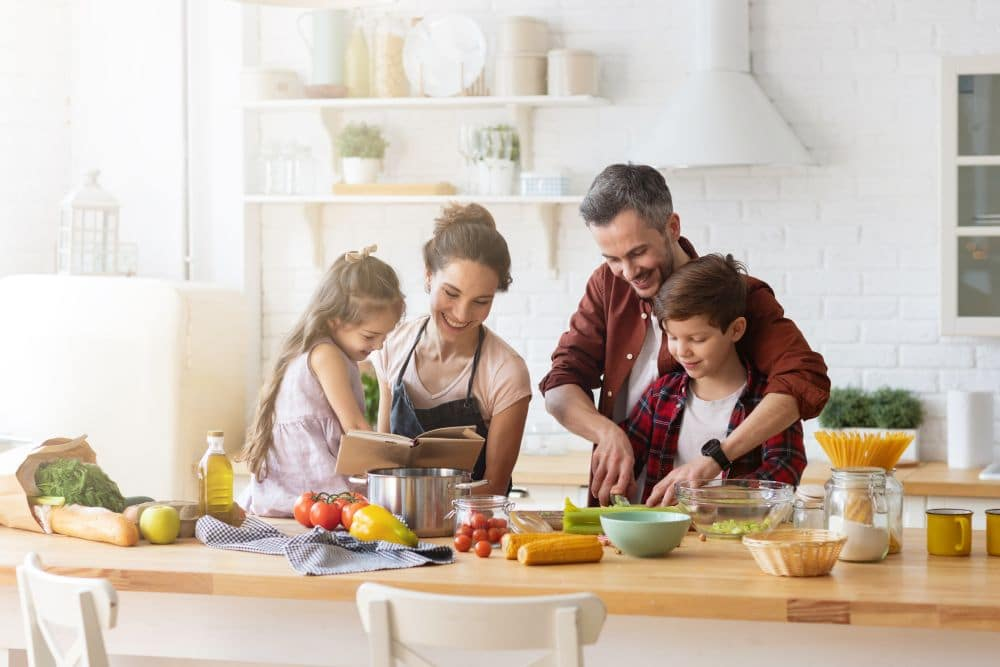 Happy,family,cooking,together,on,kitchen.,mother,and,daughter,reading