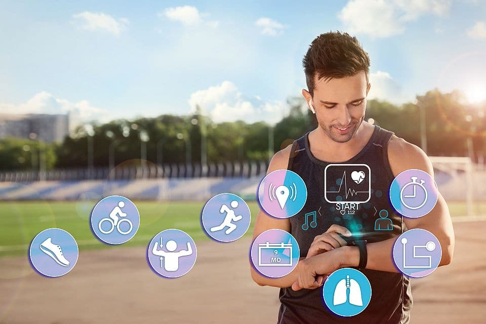 Man,using,smart,watch,during,training,outdoors.,icons,near,hand