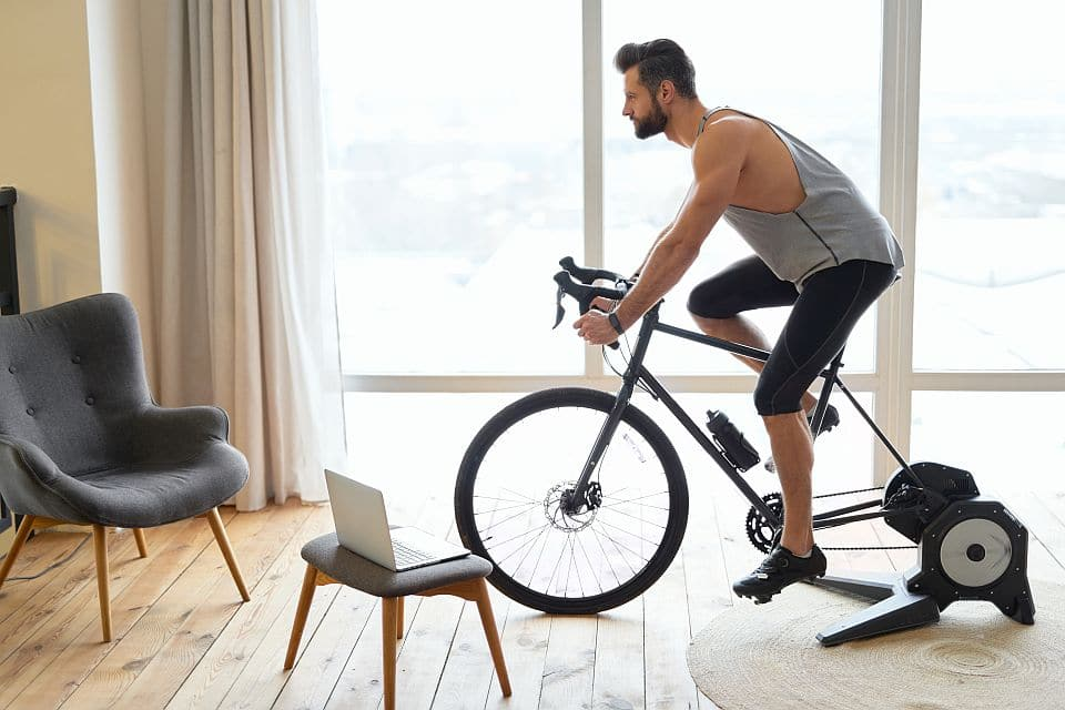 Handsome,young,man,riding,stationary,exercise,bike