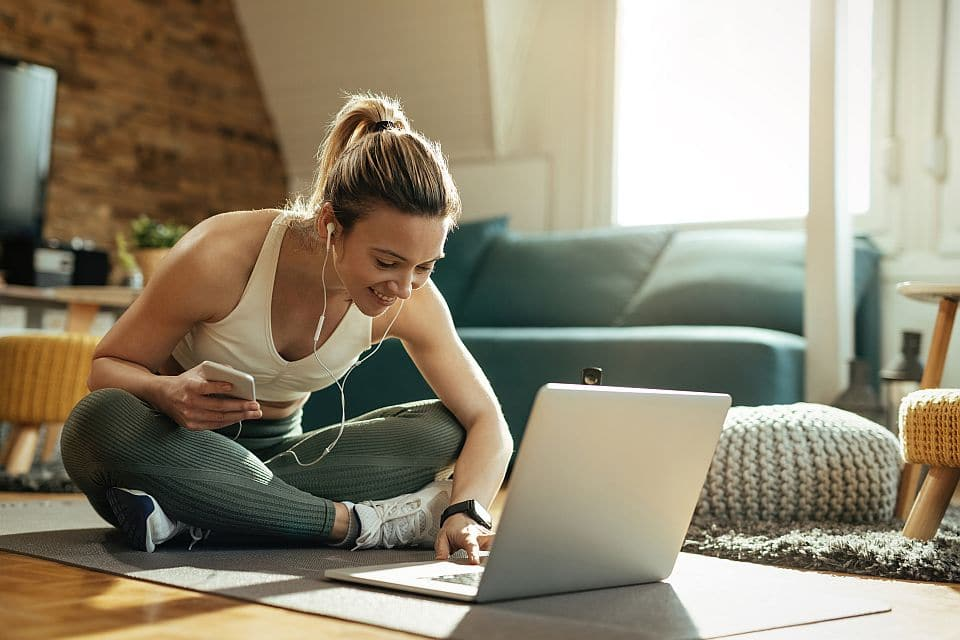 Young,happy,athletic,woman,surfing,the,net,on,laptop,while