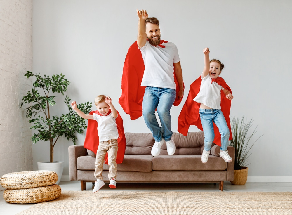 Full,body,of,cheerful,father,with,two,children,in,casual