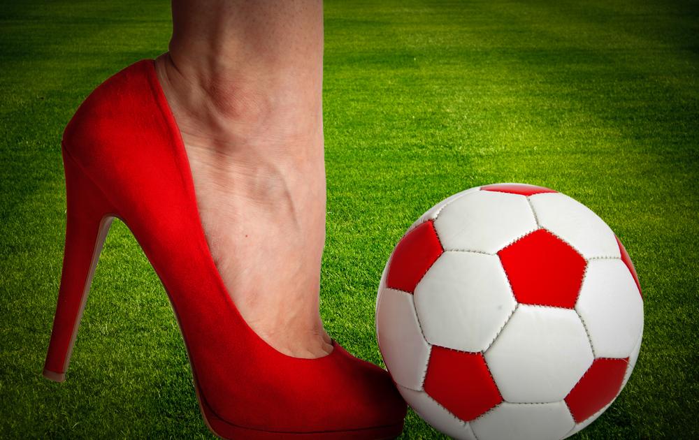 Woman,leg,in,high,heel,shoe,punch,a,soccer,ball