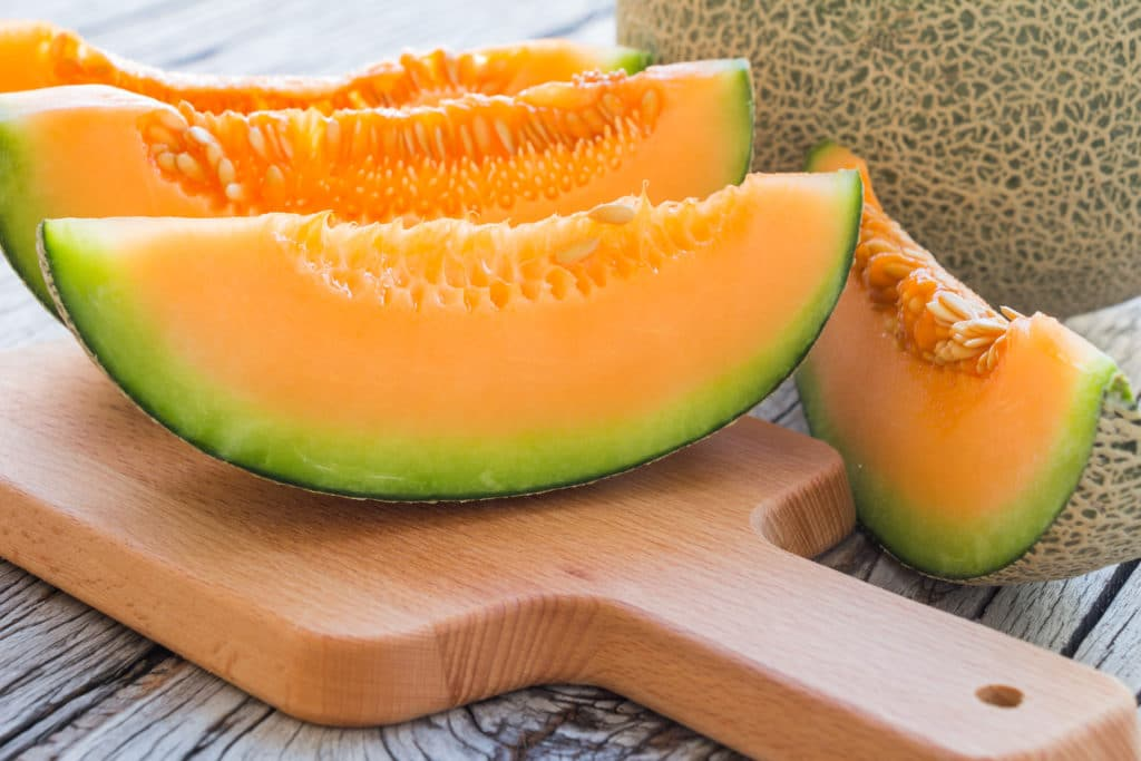 Fresh,melons,sliced,on,wooden,table