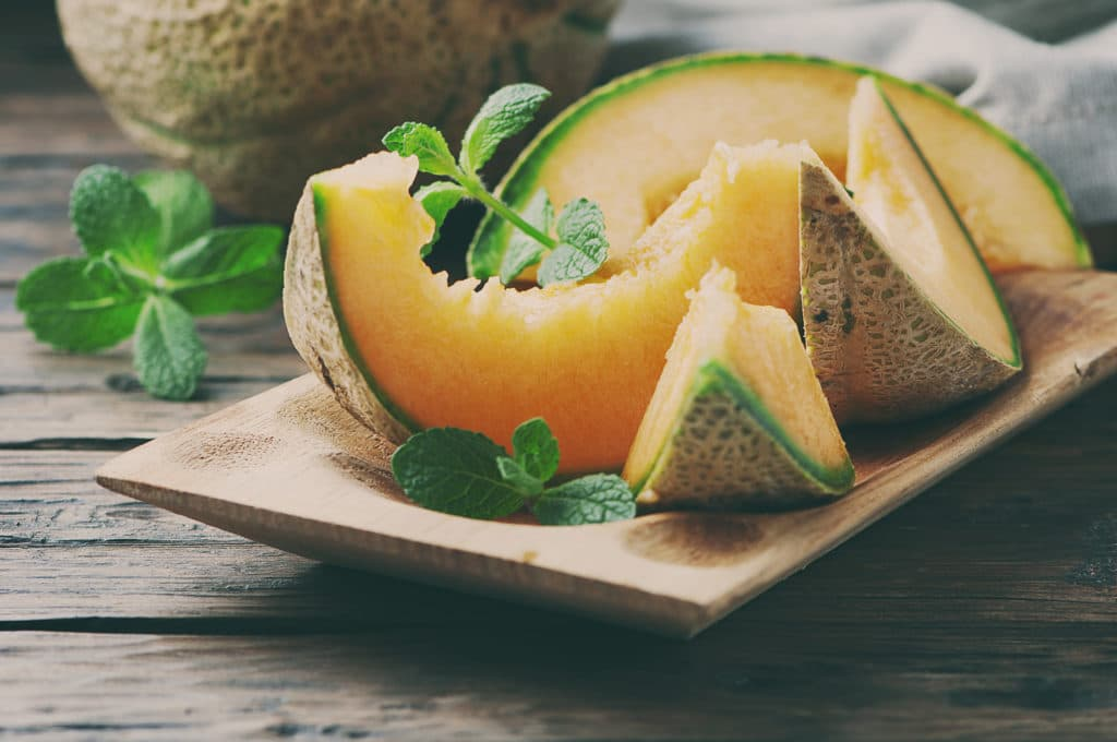 Fresh,sweet,orange,melon,on,the,wooden,table,,selective,focus