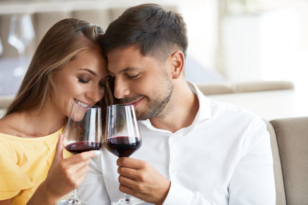 Couple,in,love,drinking,wine,in,restaurant.,portrait,of,beautiful