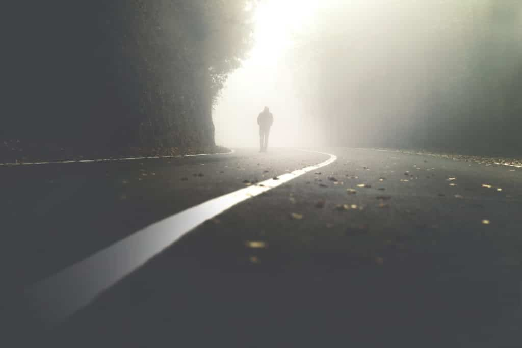 Mysterious,man,walking,in,the,mist