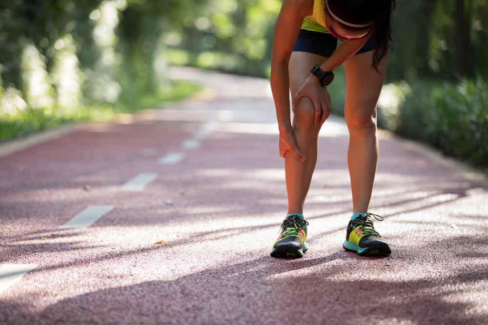 Female,runner,suffering,with,pain,on,sports,running,knee,injury