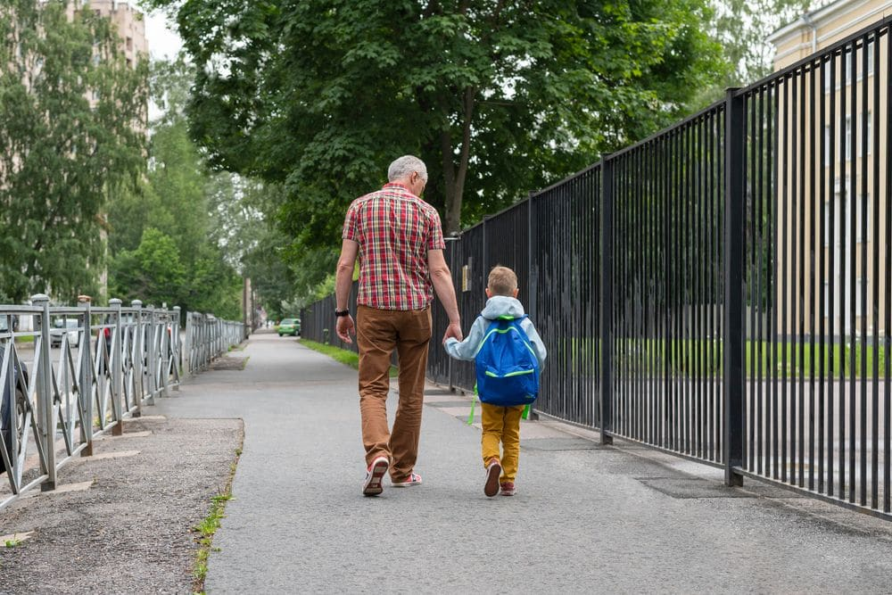 Dad,walks,his,little,son,to,school.,father,and,son