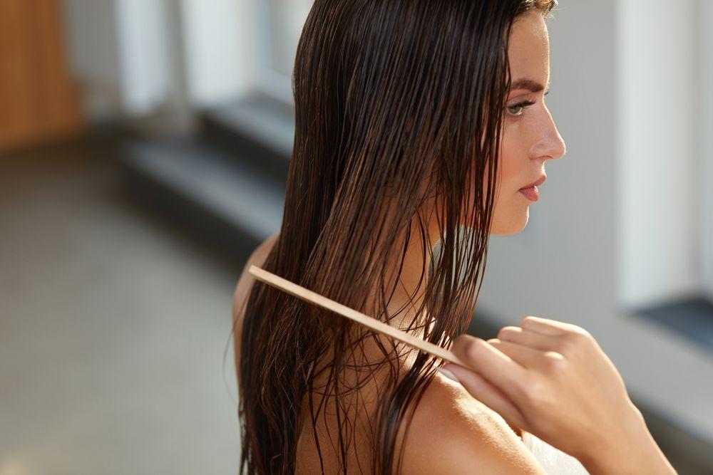 Hair,care.,closeup,of,beautiful,girl,after,bath,hairbrushing,healthy