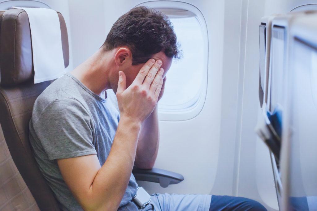 Headache,in,the,airplane,,man,passenger,afraid,and,feeling,bad