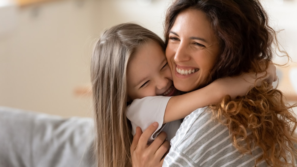 Cute,little,girl,hug,cuddle,excited,young,mum,show,love