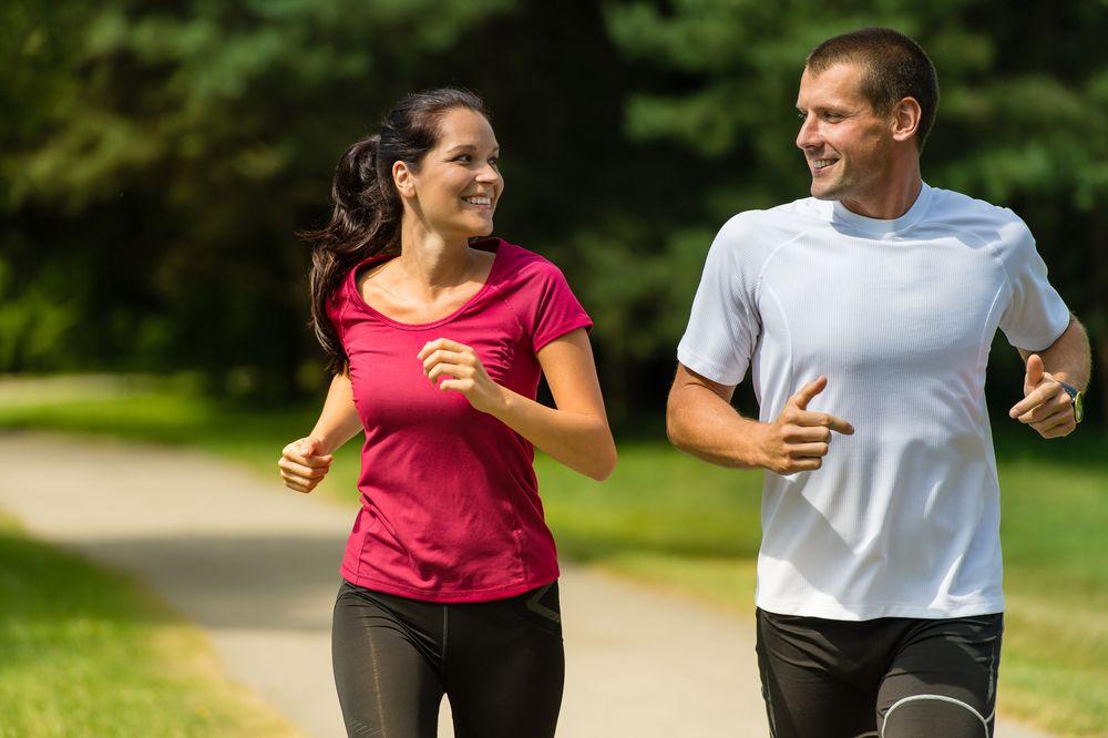Portrait,of,cheerful,caucasian,couple,running,outdoors