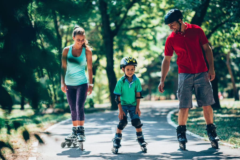 Cheerful,family,roller,skating,in,park