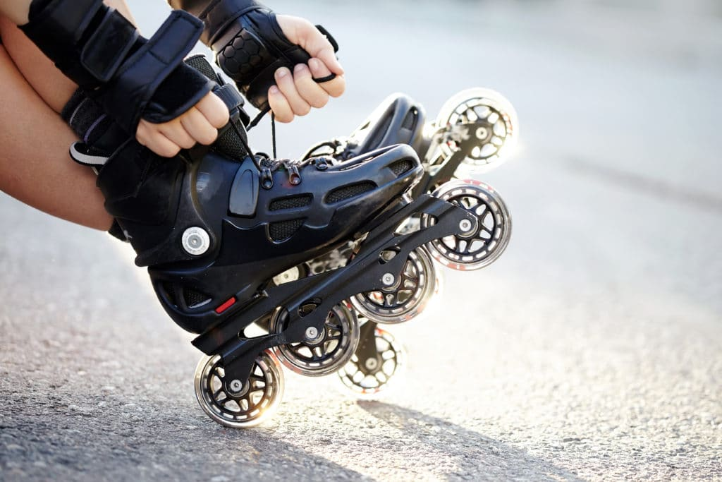 Setting,of,laces,on,black,roller,skates