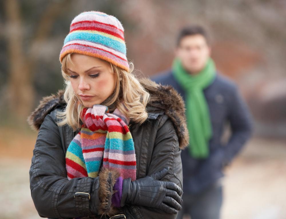 Couple,on,winter,walk,through,frosty,landscape