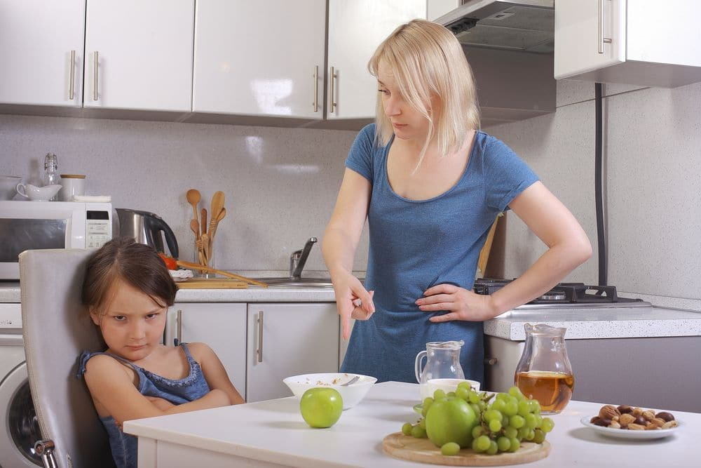 In,the,kitchen.,mother,scolding,a,child.,a,child,refuses
