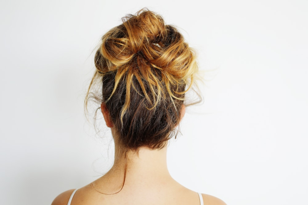 Young,woman,with,messy,bun,hairstyle.