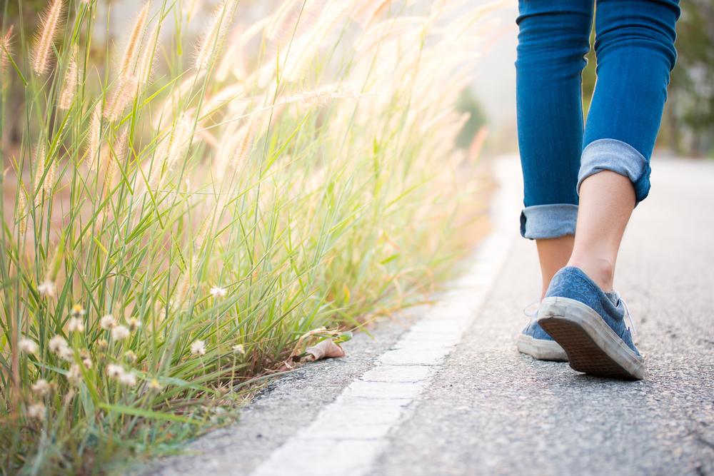 Walking,women,jeans,and,sneaker,shoes