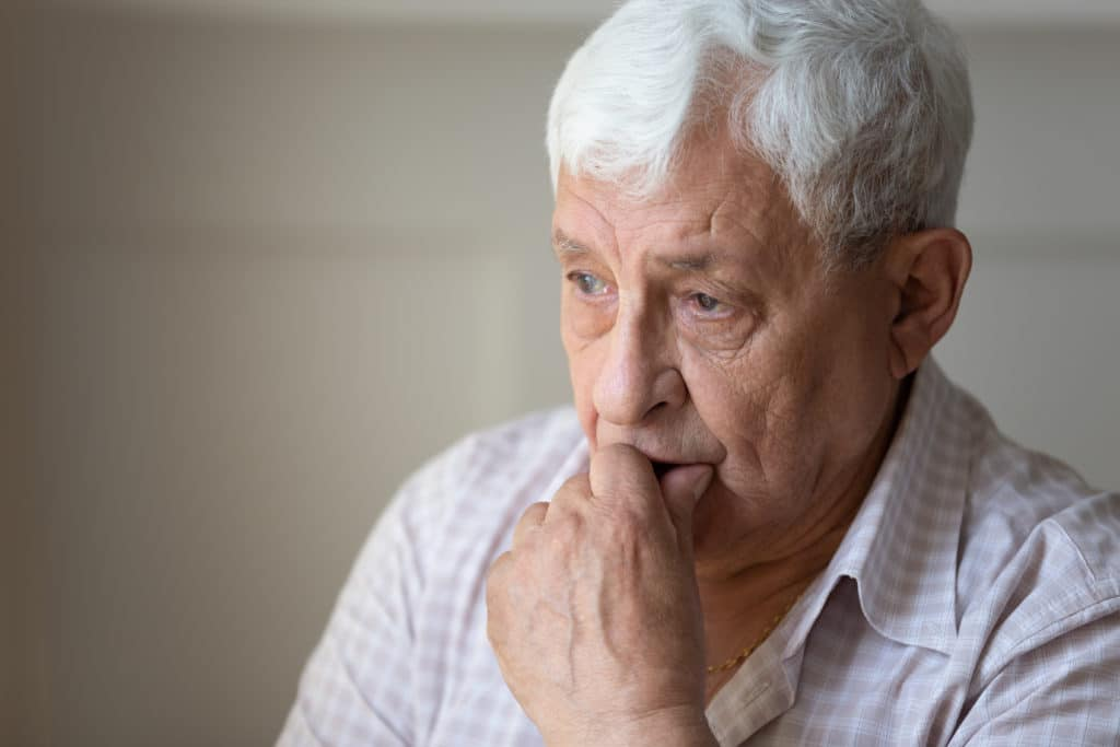 Close,up,of,sad,thoughtful,old,grandfather,look,in,distance