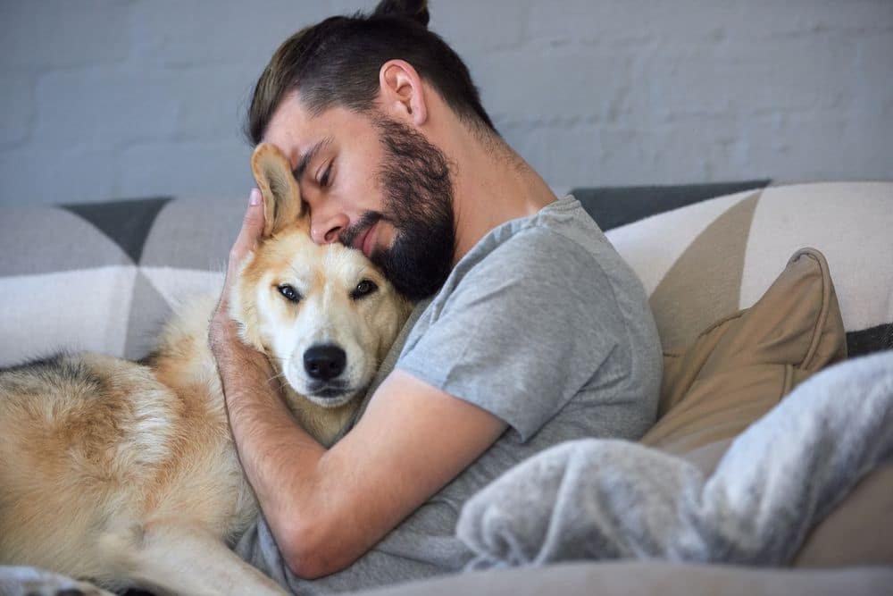 Hipster,man,snuggling,and,hugging,his,dog,,close,friendship,loving