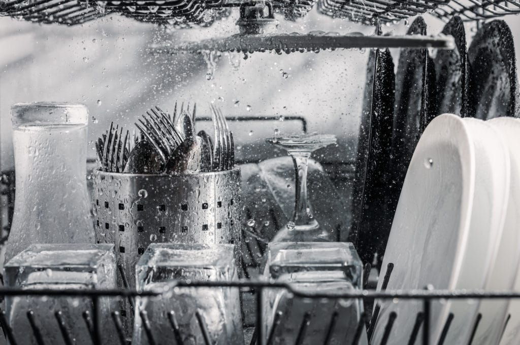 Transparent,and,black,and,white,dishes,as,well,as,cutlery